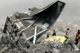 At least 23 miners and dozens of vehicles were buried by the collapse [AFP]
