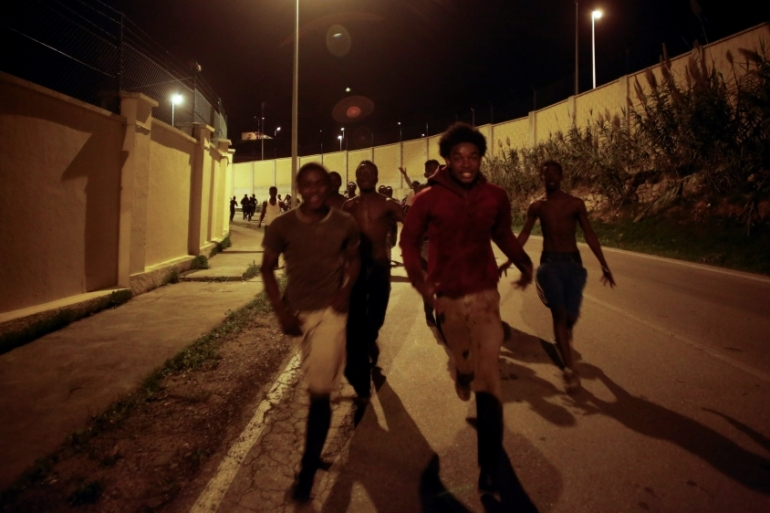 In a span of three days, almost 900 people crossed the Ceuta border [Reuters]