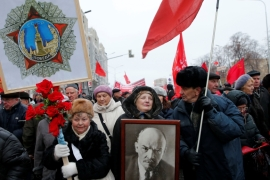 Communist supporters carry Lenin's portrait in a rally marking the anniversary of the 1917 Bolshevik revolution [Maxim Zmeyev/Reuters]