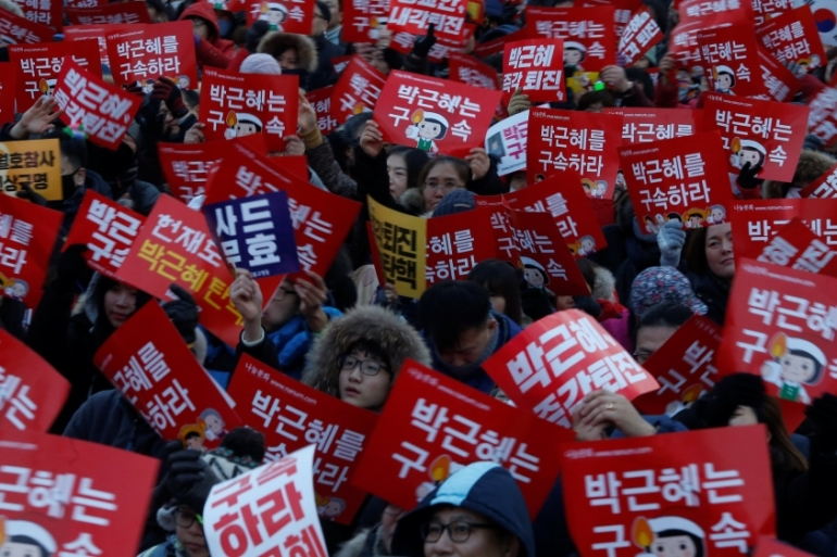 Mass protests have been held for weeks demanding Park Geun-hye's resignation [Kim Hong-Ji/Reuters]