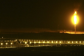 Shaybah oilfield complex is seen at night in the al-Khali desert in Saudi Arabia [File: Ali Jarekji/Reuters]