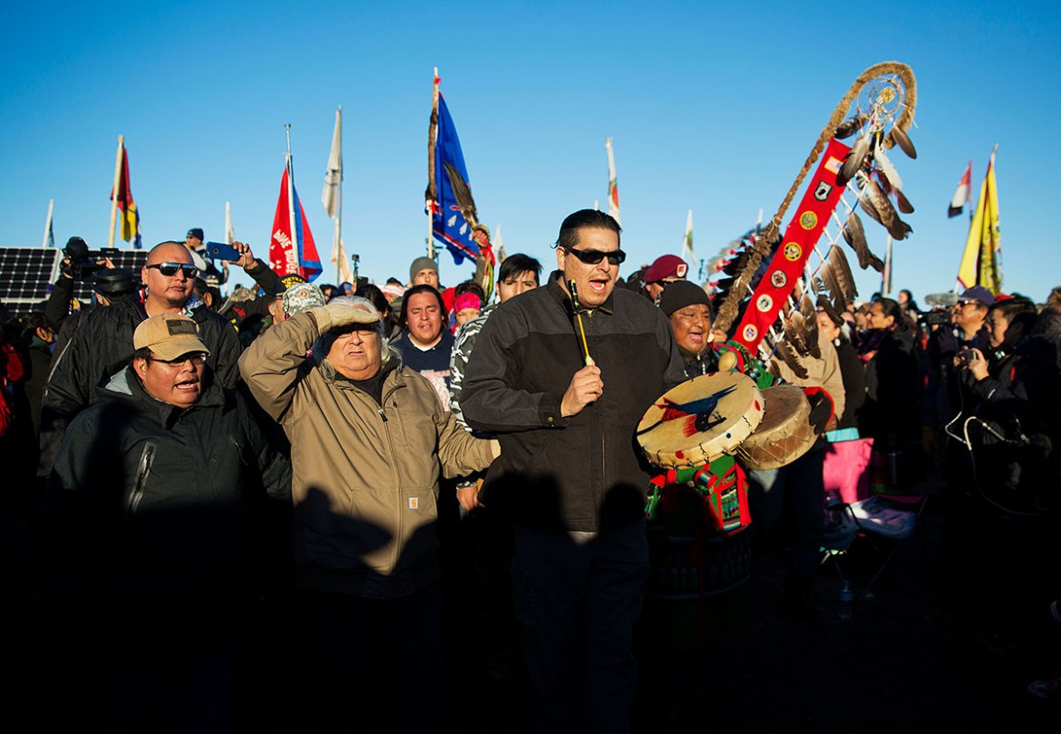Activists at the camp were seen hugging each other and letting out Native American war cries on Sunday, but many remained wary, knowing that President-elect Donald Trump has voiced support for the line. [David Goldman/AP]