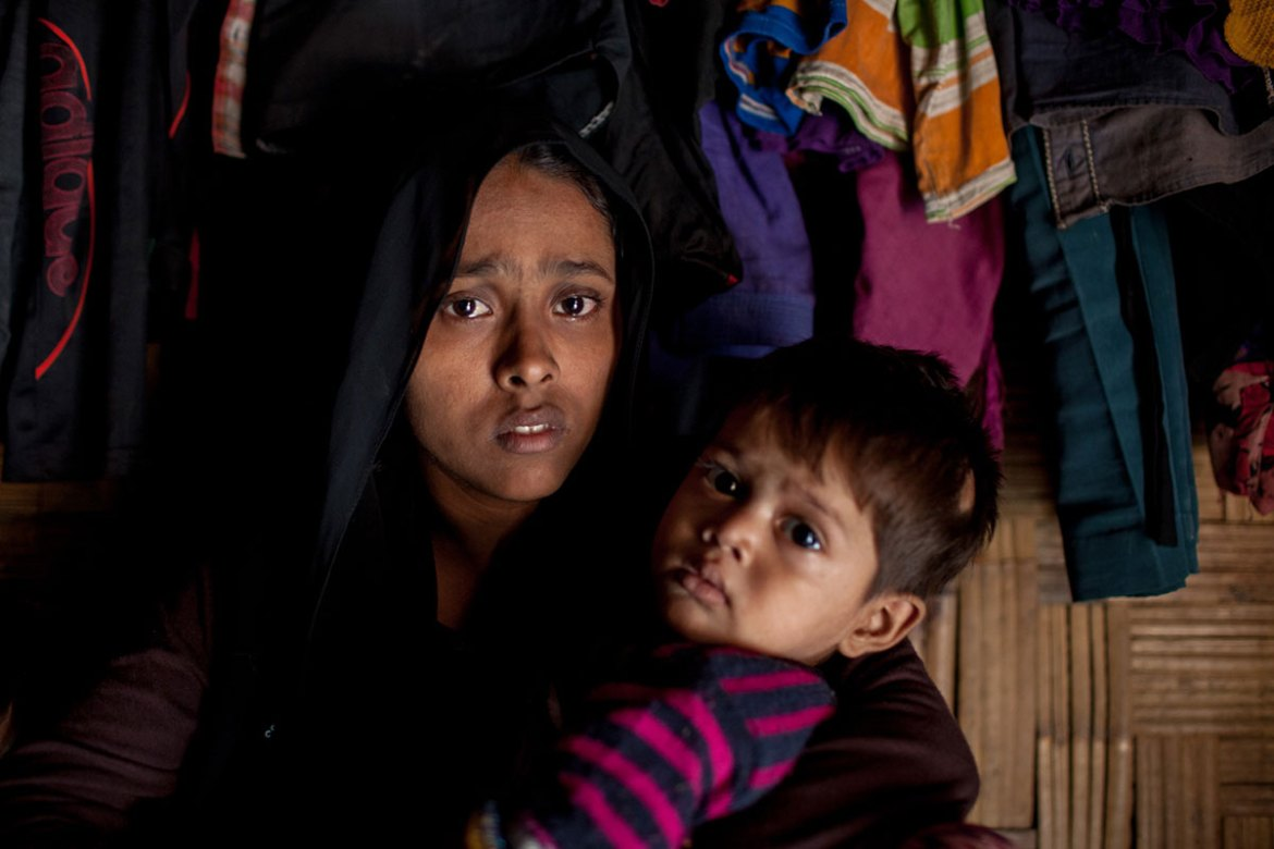 'The military killed my husband and torched our home. I fled in a jungle along with my two children. After trying for three days, I managed to reach here. I don't want to recall the horrors,' said Sitara Begum, 21, at Leda camp. [Mahmud Hossain Opu/Al Jazeera]