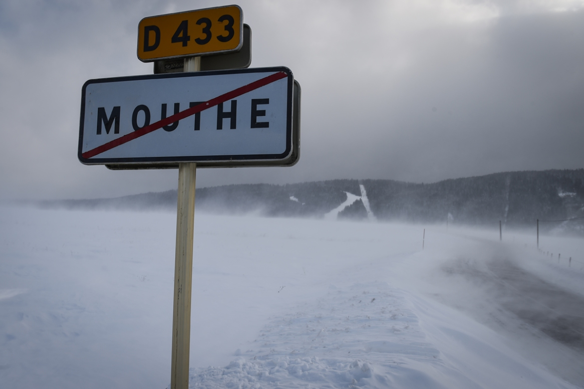 Snow making drifts on the roads near the French city of Mouthe, France. [ Sebastien Bozon/AFP] [AFP]