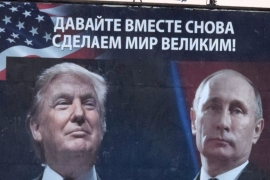 A billboard by a pro-Serbian movement shows the image US President-elect Donald Trump and Russian President Vladimir Putin in the town of Danilovgrad, Montenegro [EPA]