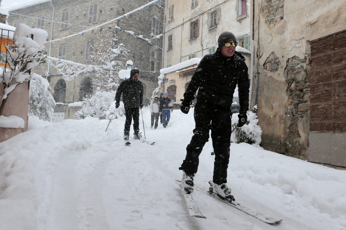 Skiing the streets of snow-covered Corte, Corsica. [Pascal Pochard-Casiabianca/AFP]