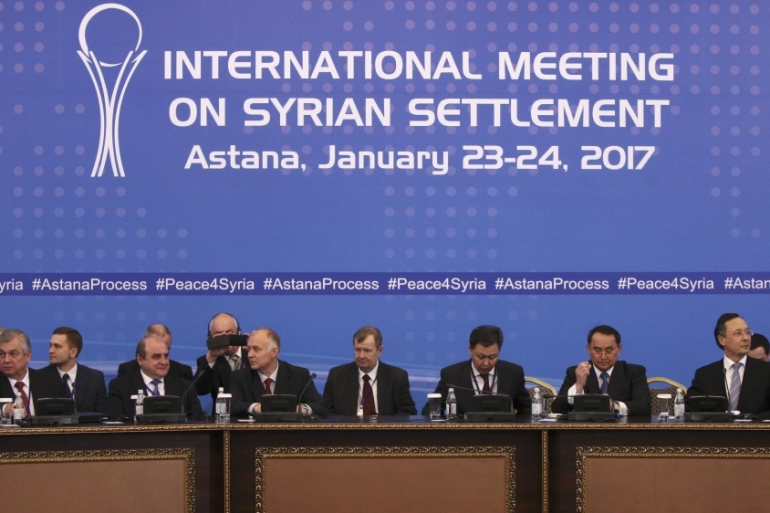 Participants of Syria peace talks attend the meeting in Astana, Kazakhstan, on January 23 [Reuters/Mukhtar Kholdorbekov]
