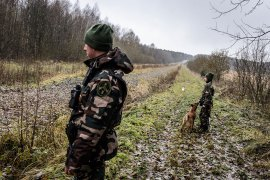 Border guards Rafal and Egle respond to a seismic alarm on the Belarusian-Lithuanian border. They scout the area to determine the cause for the alarm. In this case, it was most likely caused by a migrating animal. [Benas Gerdziunas/Al Jazeera]