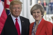 US President Donald J Trump greets British Prime Minister Theresa May as she arrives at the White House in Washington, DC [Shawn Thew/EPA]