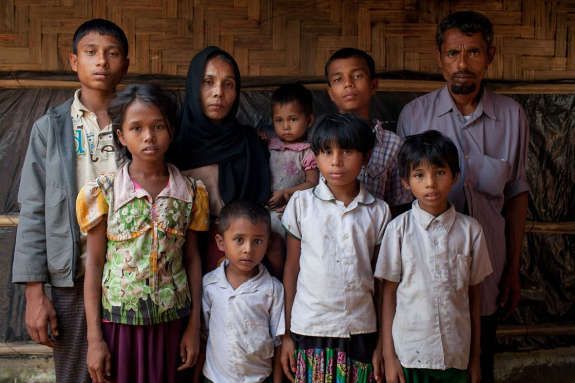 Amir Hossain, 40, fled Myanmar along with his seven children for safety in Bangladesh. But, they are left in limbo as the Bangladesh government does not recognise them as refugees. [Mahmud Hossain Opu/Al Jazeera]
