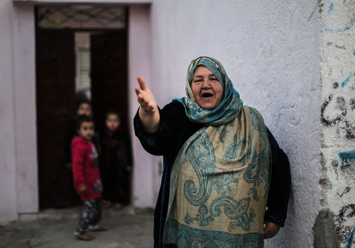 Standing in front of her home in Jabaliya refugee camp, one woman told Al Jazeera: 'We have no life here. Tell the world to bring us electricity so we can have a life again.' [Ezz Zanoun/Al Jazeera]