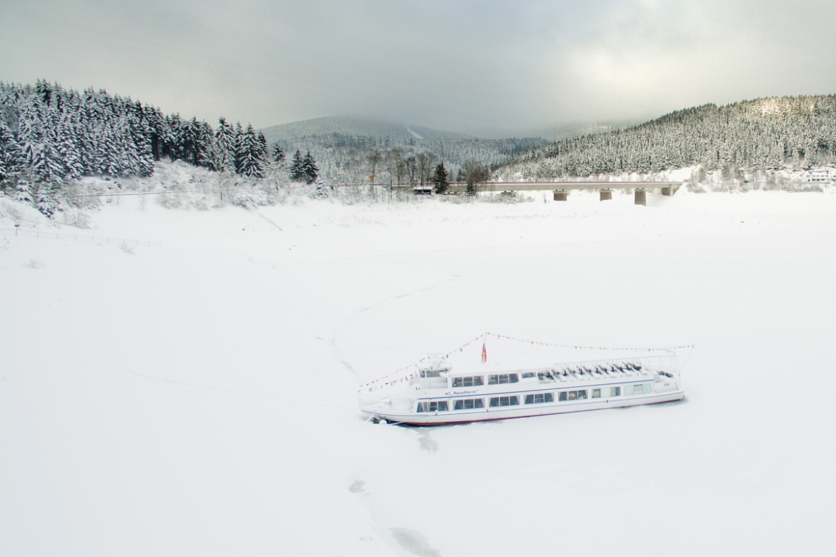 Nowhere to go as the the excursion boat MS AquaMarin is locked in by snow and ice on the Okerstausee reservoir, Germany. [Julian Stratenschulte/AFP]