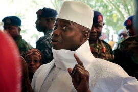 President Yahya Jammeh shows his inked finger before voting in Banjul on December 1, 2016 [AP]