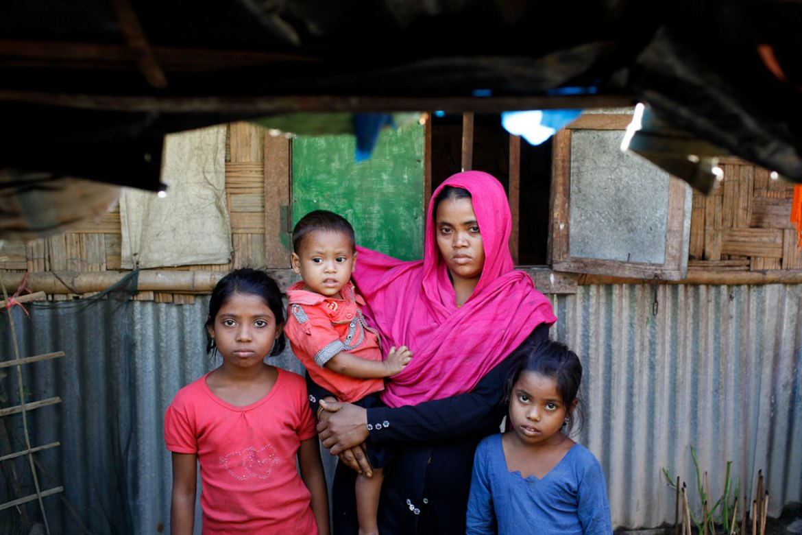 Toiyaba, 30, arrived at Leda refugee camp with her three children, barely escaping with their lives. [Mahmud Hossain Opu/Al Jazeera]