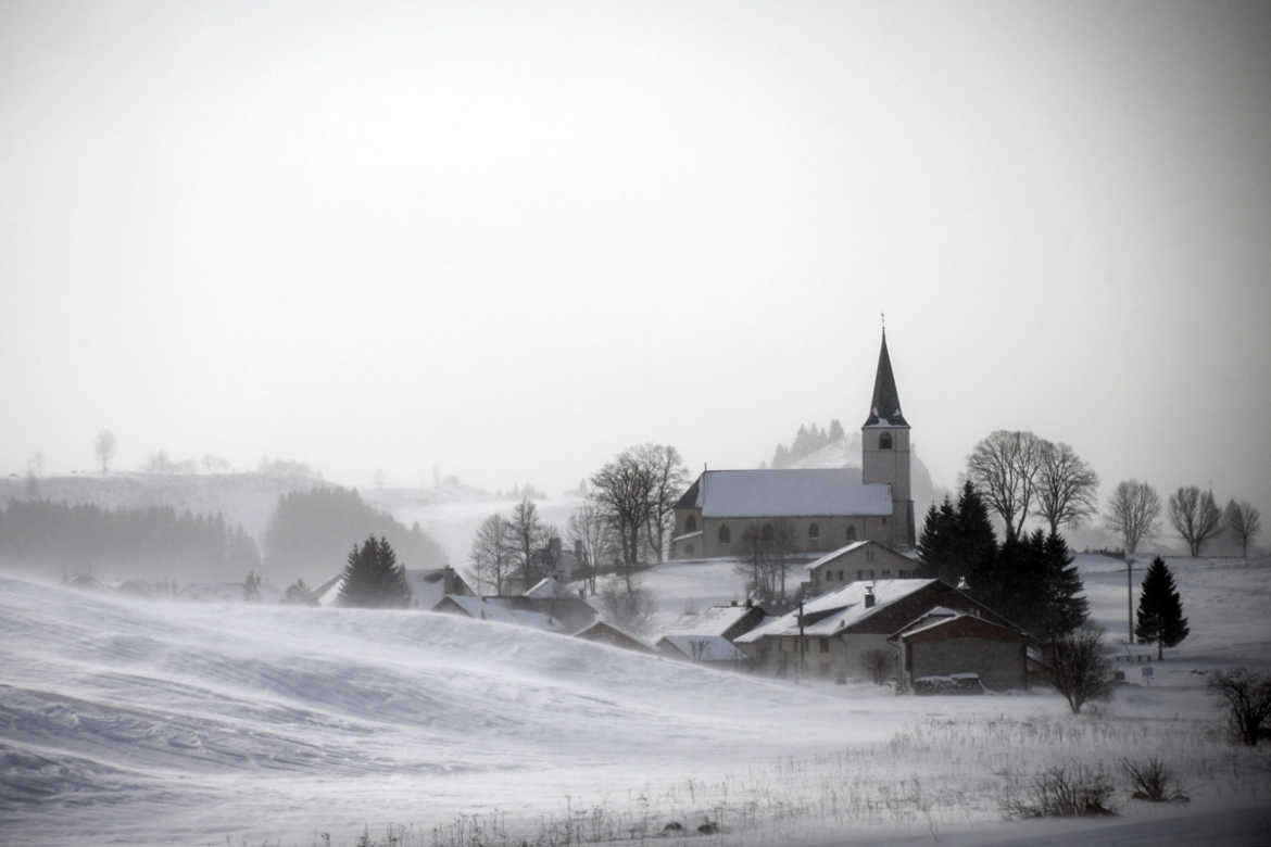 Snow and fog make for a picture-perfect misty white countryside near Chatelblanc, France. [Sebastien Bozon/AFP]