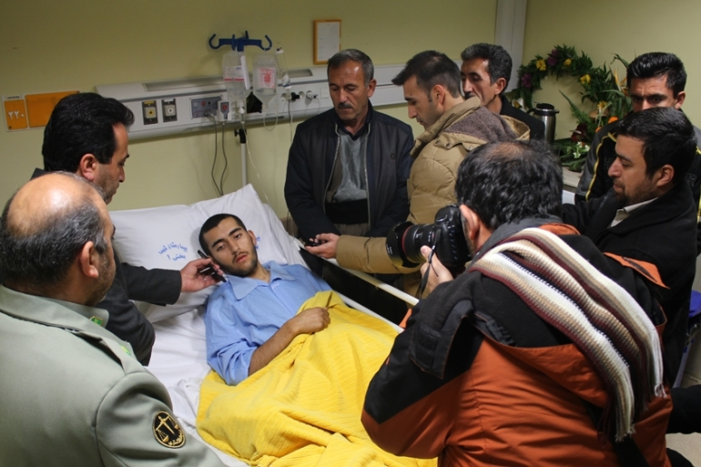 Local officials visited Bakhtar in hospital in Tabriz while he was recovering from his amputation last month [Neda Soleymani/Al Jazeera]