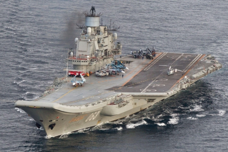 A Russian official said aircraft carrier Admiral Kuznetsov will be the first to leave the conflict zone [Reuters]