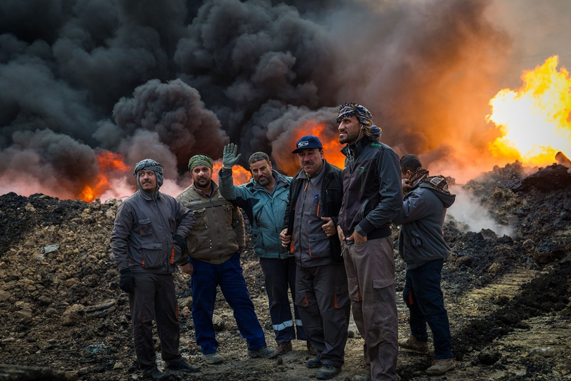 Fires have been raging since the town of Qayyarah was retaken by Iraqi forces in August. [Claire Thomas/Al Jazeera]