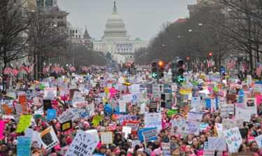Hundreds of thousands march down Pennsylvania Avenue during the Women's March in Washington DC on January 21 [Reuters]