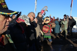 Minutes after word of the Army Corps' announcement reached the camp, a jubilant crowd processed down the main artery of Oceti Sakowin, known as Flag Row [Adam Levinson/Al Jazeera]