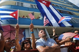 Cubans and visitors from other countries gather to observe the flag-raising ceremony for the newly reopened US embassy on August 14, 2015 in Havana, Cuba [Chip Somodevilla/Getty Images]