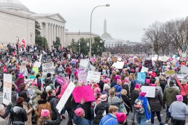 Protesters make their way down Pennsylvania Avenue, originally not part of the route. Numbers exceeded the expected 200,000, making a single route to the White House impossible. [Kelly Lynn Lunde/Al Jazeera]