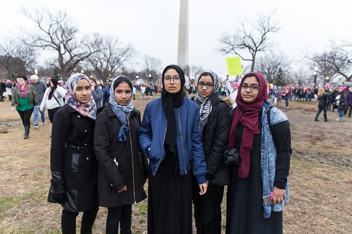 Danya Chowdhury, 19, from Maryland, Ashna Mahmud, 18, and Nazifa Mahmud, 15, both from Bangladesh, and Huma Chowdhury, 17, and Ruqayyah Khan, 19, both from Maryland, are friends and cousins. 'I feel like since we've been here, we've met so many people that are kind to us and who actually are [against] Islamophobia.  We don't normally see that.  Like when we're walking down the street sometimes people just stare,' said Ruqayyah. [Kelly Lynn Lunde/Al Jazeera]