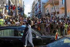 Well-wishers as Barrow (unseen) is driven after his inauguration at the Gambian embassy in Dakar [Reuters/Office of the Senegal Presidency]