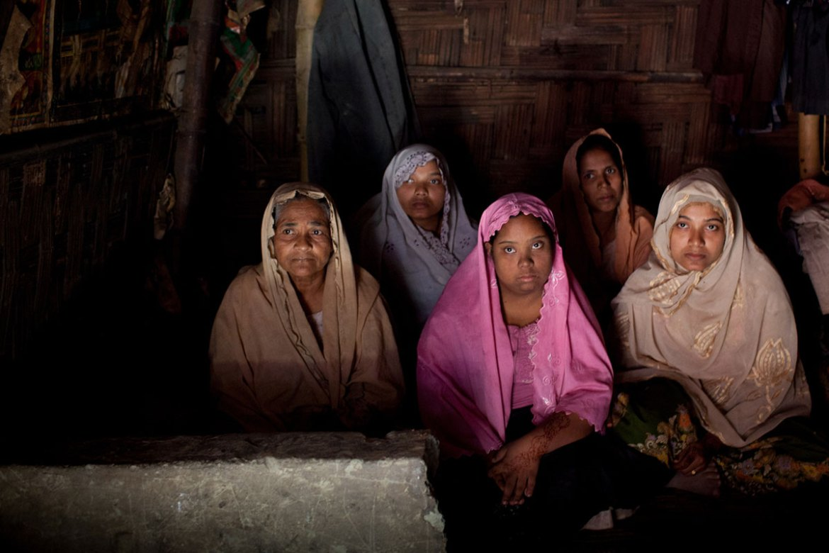 Nurun Nahar, 60, and her four daughters fled after her house was attacked by the army. [Mahmud Hossain Opu/Al Jazeera]