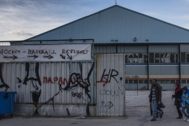 Refugees leave the military-run camp at the abandoned Elliniko airport in Athens, Greece. March, 2016 [Fahrinisa Oswald/Al Jazeera]