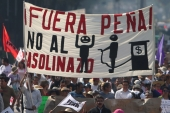 Protesters march during a demonstration in downtown Mexico City against the rising prices of gasoline enforced by the Mexican government [Reuters]