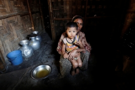 A Rohingya woman with her son at a camp near Cox's Bazar [File: Mohammad Ponir Hossain/Reuters]