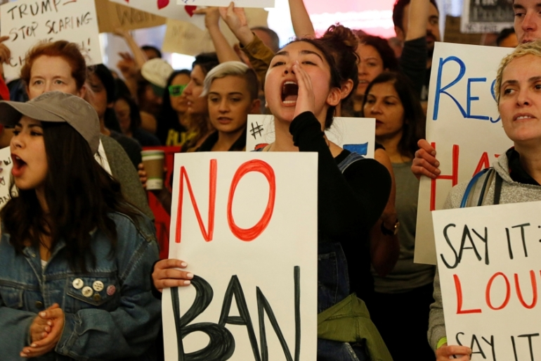 File: Demonstrators yell slogans against the travel ban at Los Angeles International Airport [Ted Soqui/Reuters]