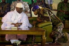 A Gambian officer speaks to President Jammeh in the capital Banjul in November 2016 [Jerome Delay/AP]