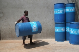 UNICEF workers assemble 'school infection prevention kits' to stop the spread of Ebola in schools in Monrovia, Liberia [Getty Images]