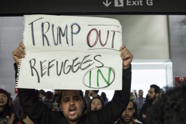 US President Donald Trump's executive order barred Syrian refugees indefinitely and imposed a 90-day suspension on visas for nationals of seven majority-Muslim countries [EPA]