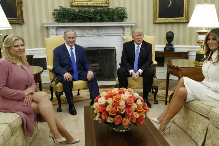 US President Donald Trump and first lady Melania meet Israeli Prime Minister Benjamin Netanyahu and his wife Sara in the Oval Office of White House on February 15 [Kevin Lamarque/Reuters]