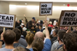 Protesters gather to denounce President Donald Trump's executive order that bans certain immigration, at Dallas-Fort Worth International Airport [G. Morty Ortega/Getty Images]
