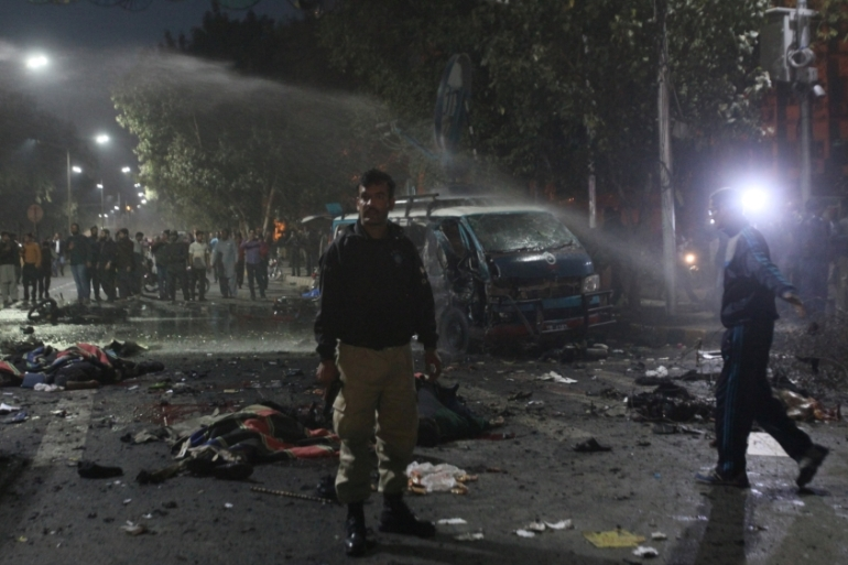 Security forces arrive at the blast scene in central Lahore [Mohsin Raza/Reuters]