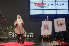 Abdulrahman spoke at Gaza's first-ever TEDx event on October 29, 2015, as a cancer survivor and an artist with a story to tell. After her eight-year battle with cancer, which put an end to her marriage, the 26-year-old became a spokeswoman for cancer patients in Gaza and a proactive illustrator, exhibiting her work around Gaza. 'In my exhibitions, I was seen as Aya the successful artist – not Aya the cancer patient,' she said. [Hosam Salem/Al Jazeera]
