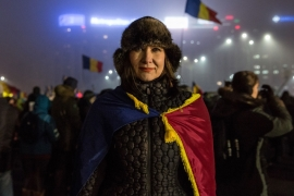Thousands gathered for the eighth consecutive evening in Victory Square outside government offices [Ioana Moldovan/Al Jazeera]