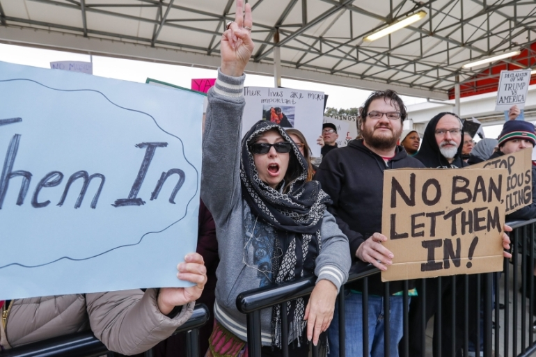 People gather and hold signs during a protest at Hartsfield-Jackson Atlanta International Airport after new immigration policies enacted by Donald Trump in Atlanta on January 27 [EPA]
