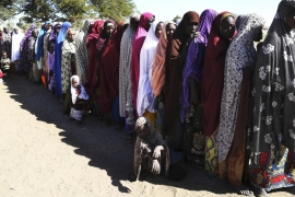 Women who have fled violence in Nigeria queue for food at a refugee welcoming centre in Ngouboua, Chad on January 2015 [Emmanuel Braun/Reuters]