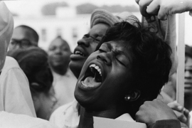 An African American woman yells 'Freedom' when asked to shout so loud it will be heard all over the world at the March on Washington in August 1963 [Express Newspapers/Getty Images/File]