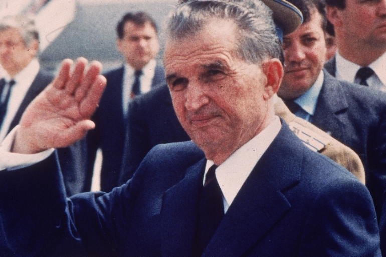 Romania's communist leader Nicolae Ceausescu waves to the crowds in May 1987, two years before his regime was brought down [AP]