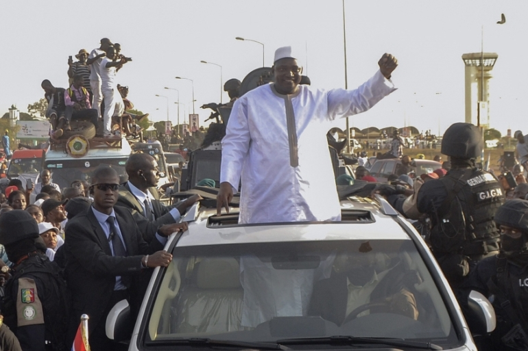 Gambia's new president Adama Barrow waving from a car to his supporters as he arrives from the airport in Banjul, Gambia, January 26, 2017 [EPA]
