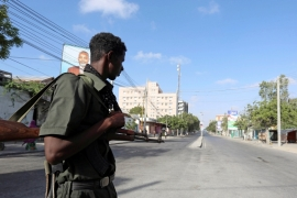 File: A policeman stands guard during a lockdown in Mogadishu [Feisal Omar/Reuters]