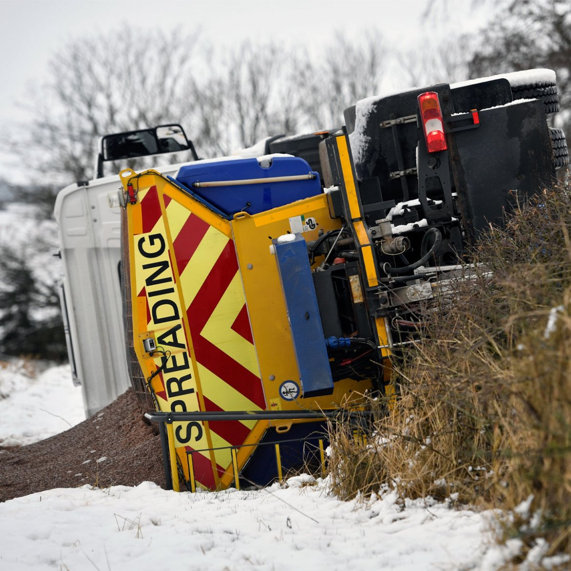 An embarrassing failure as the gritting lorry itself falls victim to a slippery road in central Scotland [Jeff J Mitchell/Getty Images]