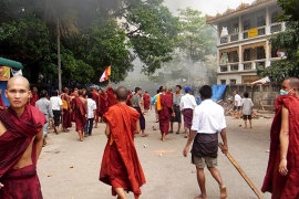 Monks and civilians gather in a street in Yangon, Myanmar on September 26, 2007, during a clash between troops and civilians [Democratic voice of Burma/EPA]