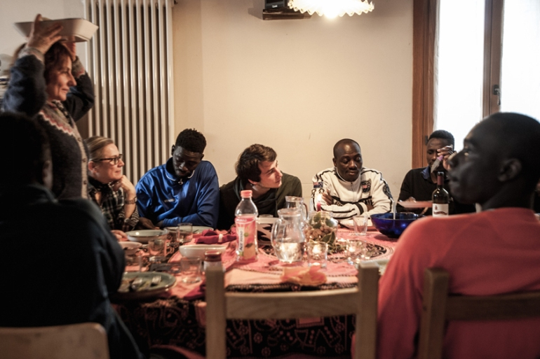 The Calo family has taken in six refugees, whom they are helping integrate into Italian society and learn about Italian cultures [Mattia Cacciatori /Al Jazeera]